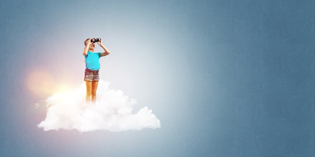 become: Cute kid girl standing on cloud and looking in binoculars