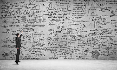 formula one: Businessman or teacher drawing science sketches at blackboard