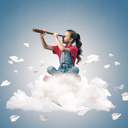 become: Cute kid girl sitting on cloud looking in spyglass and paper planes flying around