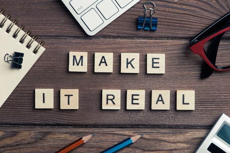 Make it real phrase spelled with game elements Stock Photo