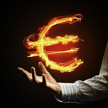Close of businessman hand showing in palm glowing euro sign