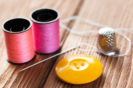 Bright image of sewing kit accessories on wooden table Stock Photo - 81770110
