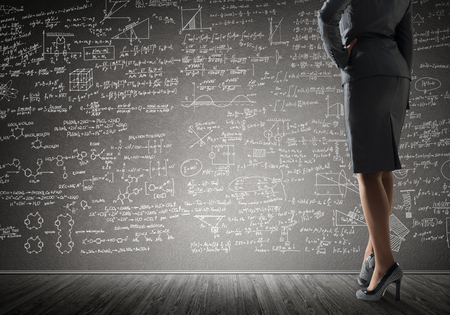 formula one: Bottom view of businesswoman or teacher and sketches at blackboard Stock Photo