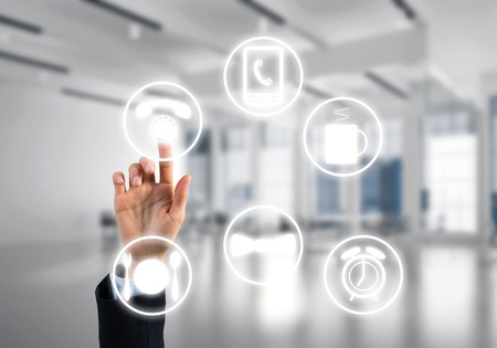 Hand of businesswoman touching icon of user panel on screen Stock Photo