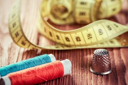 Bright image of sewing kit accessories on wooden table Stock Photo - 82086506