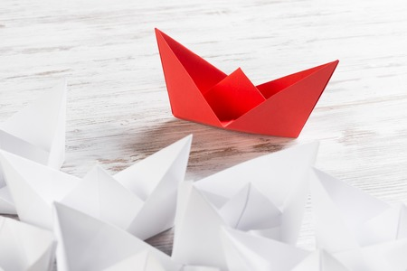 paper sheet: Set of origami boats on wooden table Stock Photo