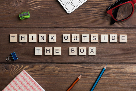 Thinking outside the box concept spelled with game elements Banco de Imagens