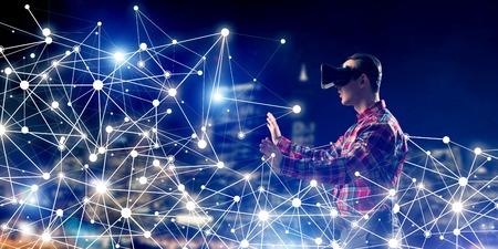 仮想現実のヘッドセットと接続線の中で 3 d メガネの若い男 写真素材