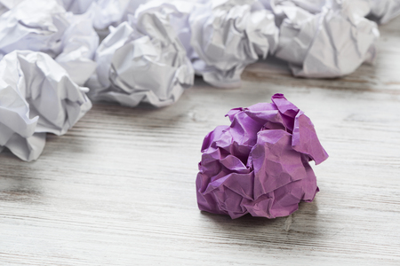 Set of crumpled paper balls with one colorful Banco de Imagens