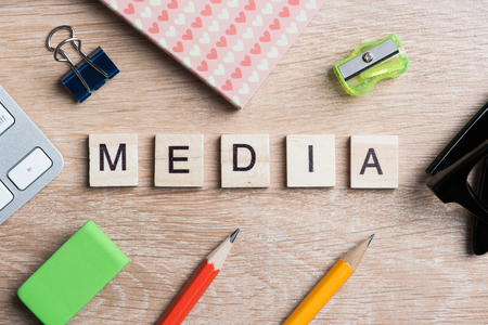 Concept of media and social communication on wooden table Stock Photo