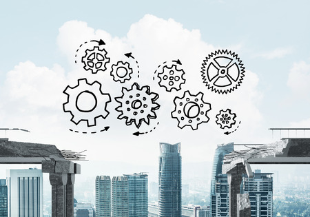 dangerous ideas: Sketched gear mechanism over gap in concrete bridge as symbol of teamwork and problem solving. Cityscape on background. 3D rendering. Stock Photo