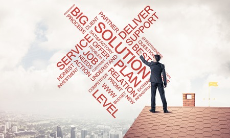 Businessman writing business related and success conceptual words. Mixed media Stock Photo