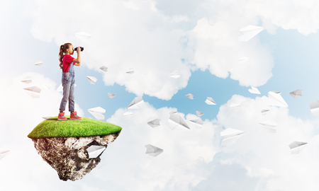 become: Cute smiling girl on floating island high in sky Stock Photo