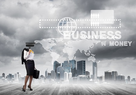 Businesswoman with camera instead of head and media user interface on screen photo