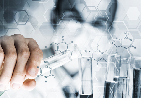 Young scientist mixing reagents in glass flask in clinical laboratory Stock fotó