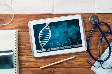White tablet pc and doctor tools on wooden table Stok Fotoğraf
