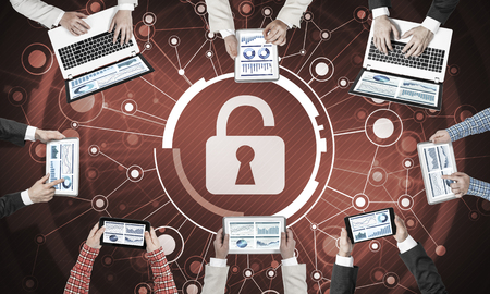 Group of people with devices in hands working together and symbol of net security and protection Stock Photo