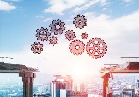 Getekende versnelling mechanisme over kloof in betonnen brug als symbool van teamwork en het oplossen van problemen. Cityscape en zonlicht op achtergrond. 3D-rendering.