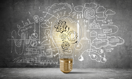 Lightbulb with multiple sketched gears inside placed against drawn business-analytical information on grey wall. 3D rendering.