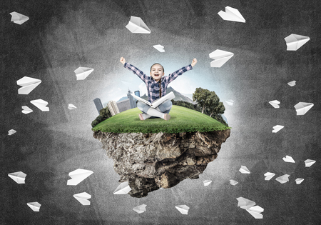 careless: ECO concept floating island and happy kid girl with book sitting on it