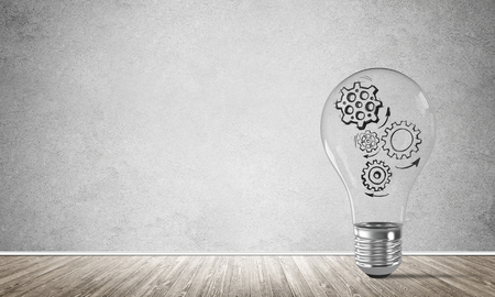 sketched shapes: Glass lightbulb with sketched multiple gears inside placed in empty room with grey wall on background. 3D rendering. Stock Photo