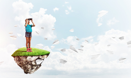 Cute smiling girl on floating island high in sky Imagens - 86143562