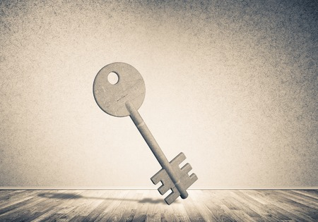 Key stone figure as symbol of access in empty concrete room Stock Photo - 86143686