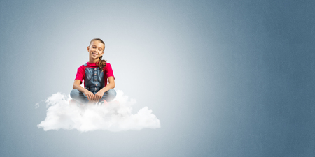 Cute kid girl sitting on cloud against blue color background Imagens - 86143780