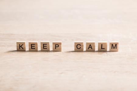 Keep calm concept collaected of wooden elements with the letters Stock Photo