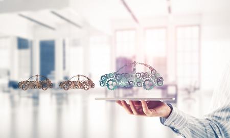 Auto pictogram gemaakt van versnellingen en tandwielen op witte kantoor achtergrond. Gemengde media