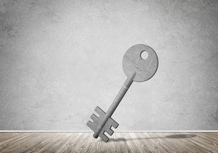 Key stone figure as symbol of access in empty concrete room Stock Photo - 87207740