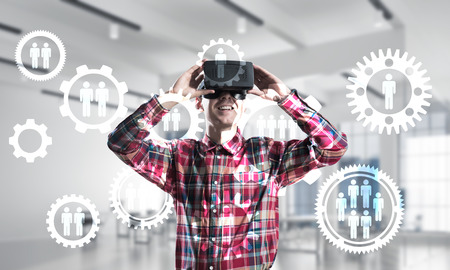 Young man with virtual reality headset or 3d glasses over social connection background