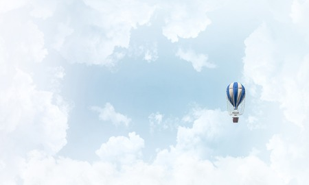 Colorful aerostat flying over the blue cloudy sky. 3D rendering.