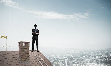 head protection: Faceless businessman with camera zoom instead of head standing on house roof