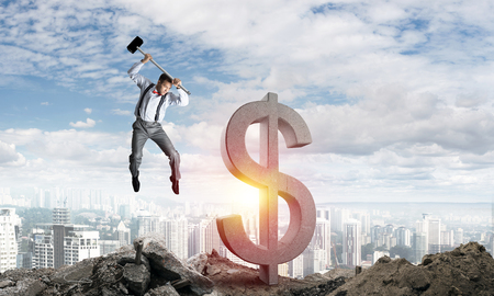 mixed media: Jumping businessman crashing big dollar symbol with city view and sunlight on background. 3D rendering.