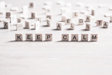 keep calm phrase collected of wooden elements with the letters Stock Photo