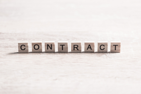 Business contract word collected of elements of wooden elements with the letters Stok Fotoğraf