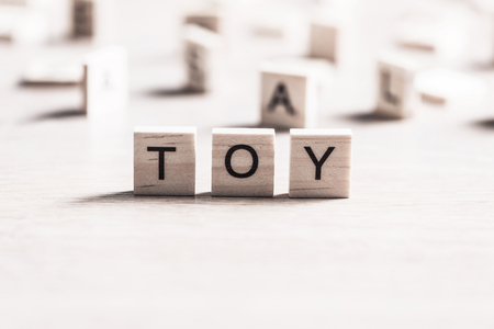 wooden elements with the letters collected in the word toy Stock Photo