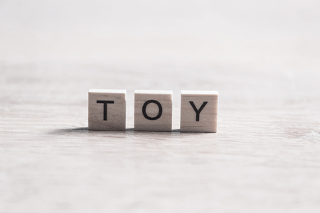 wooden elements with the letters collected in the word toy Stock fotó