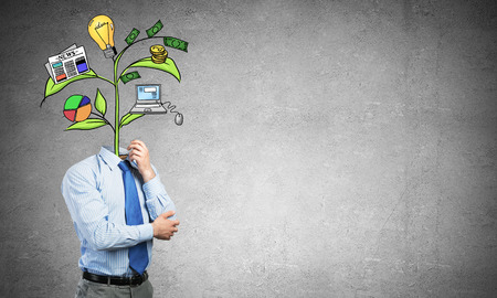 Faceless businessman in room with drawn growth concept instead of head Stock Photo
