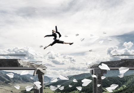 Business woman jumping over gap in bridge among flying paper planes as symbol of overcoming challenges. Skyscape and nature view on background. 3D rendering.