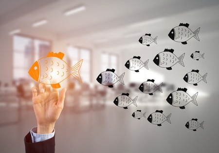 Hand of businesswoman touching glowing icon on screen and office at background Stock Photo