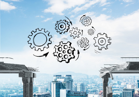 Sketched gear mechanism over gap in concrete bridge as symbol of teamwork and problem solving. Cityscape on background. 3D rendering. Reklamní fotografie