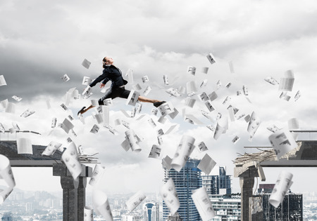 Business woman jumping over gap with flying papers in concrete bridge as symbol of overcoming challenges. Cityscape on background. 3D rendering.