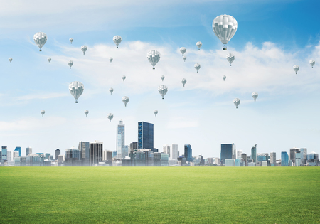 Modern cityscape with buildings and balloons in sky