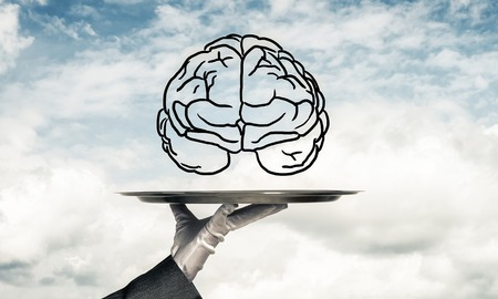 Cropped image of waitresss hand in white glove presenting sketched brains on metal tray with cloudy skyscape on background. 3D rendering. Stock Photo