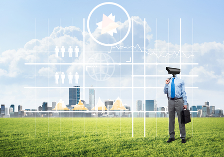 Elegant businessman outdoors with camera instead of head and media interface on screen Stock Photo