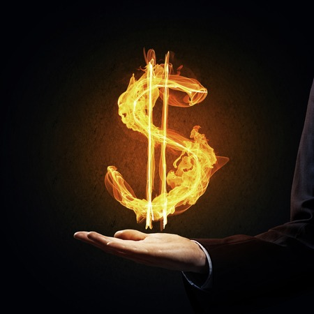 Close of businessman hand showing in palm glowing dollar sign Stock Photo