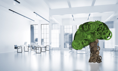 Green tree made of gears and cogwheels on white office background. 3d rendering Stock Photo