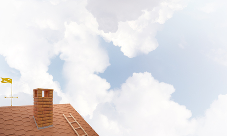Brown brick roof with chimney against blue sky background. Mixed media Stock fotó